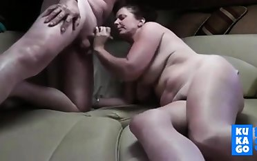 Mature couple in a stateroom boat