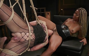 Submissive white cougar is fucked by black mistress Lotus Lain