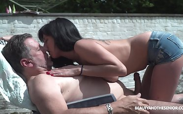 Pretty young spread out living nextdoor shows perky tits to old neighbor