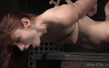 Innovative bondage for this mature redhead